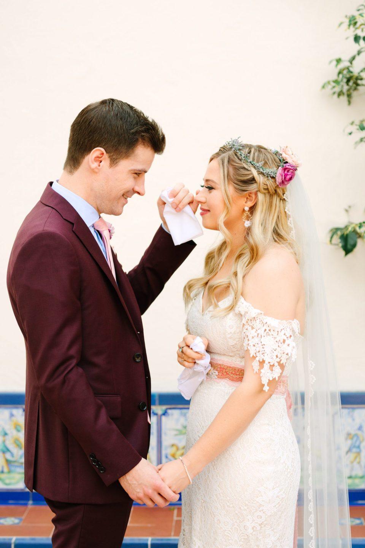 Groom catching bride's teardrop - www.marycostaweddings.com