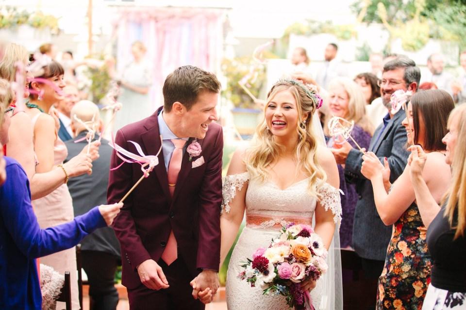 Bride and groom exiting ceremony - www.marycostaweddings.com