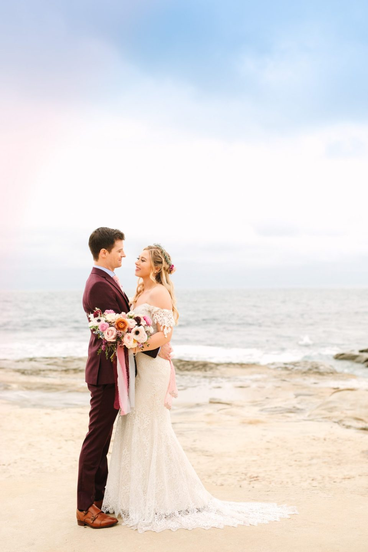 Bride and groom at the beach in La Jolla, CA - www.marycostaweddings.com