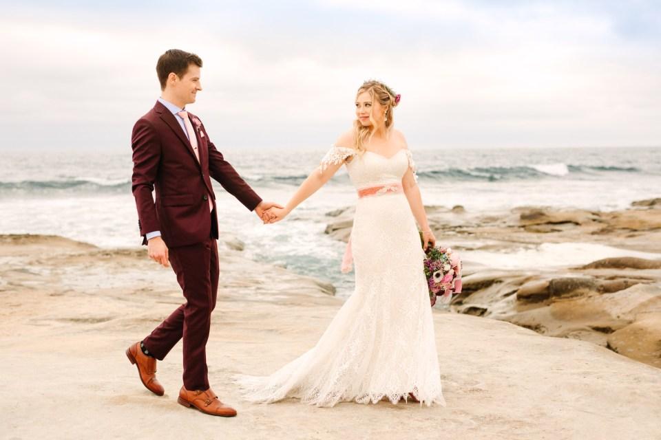 Bride and groom walking at La Jolla beach - www.marycostaweddings.com