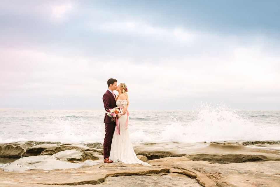 Bride and groom kissing at beach - www.marycostaweddings.com