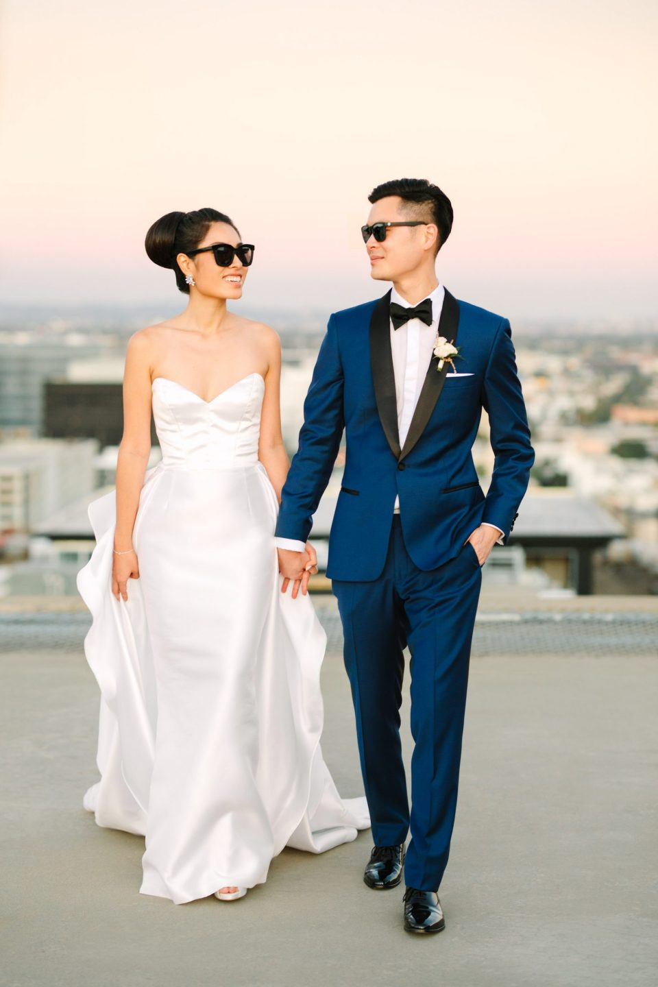 Bride and groom walking in sunglasses on Los Angeles www.marycostaweddings.com