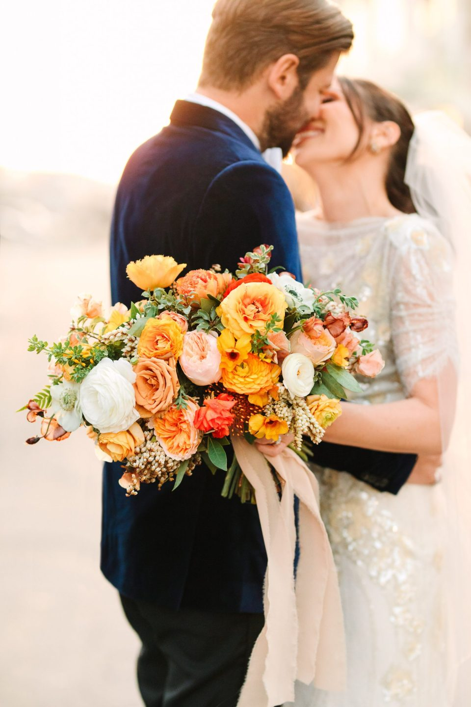 Orange and peach wedding bouquet by Mary Costa Photography