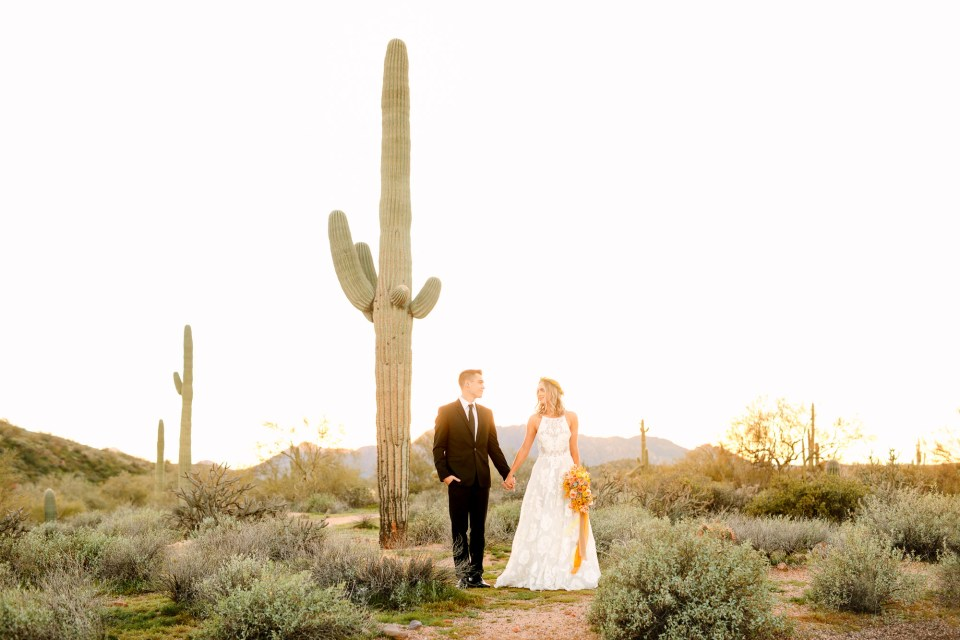 Couple with Saguaro cactus in Arizona by Mary Costa Photography