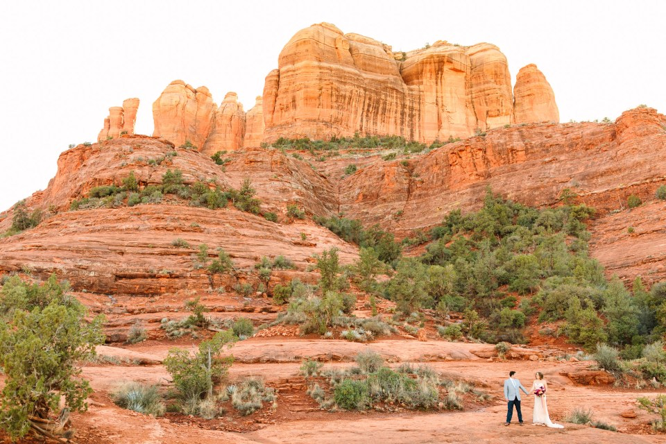 Wedding couple at Cathedral Rock Sedona by Mary Costa Photography
