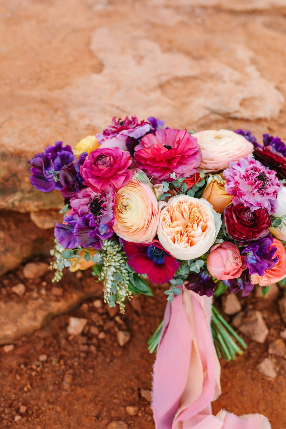 Bold Sedona wedding bouquet by Mary Costa Photography