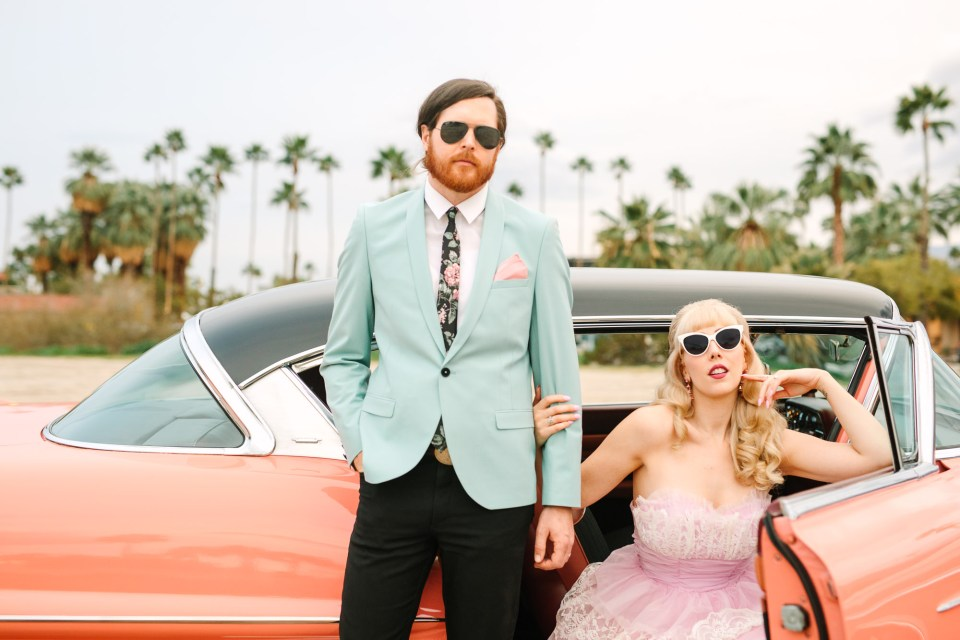 Palm Springs couple with vintage pink car by Mary Costa Photography