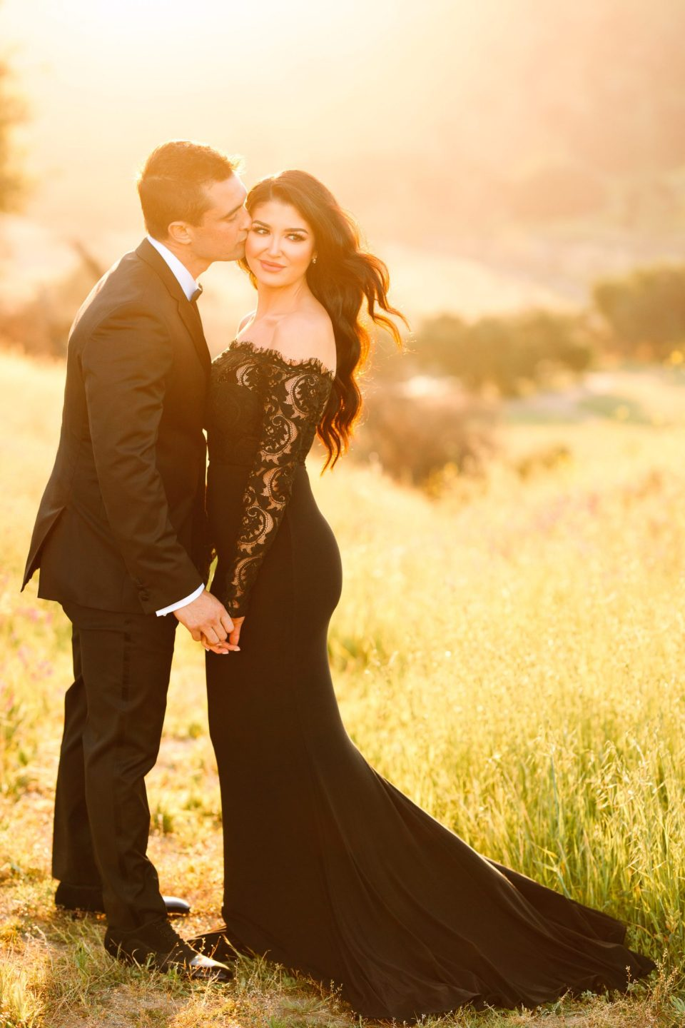Couple in black tie attire by Mary Costa Photography