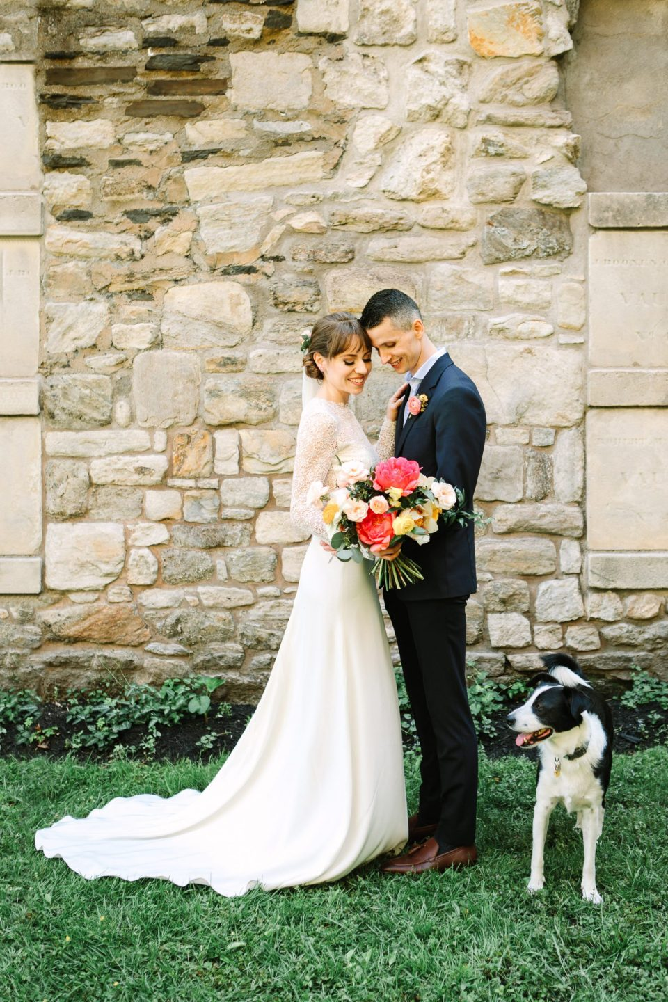 Bride and groom with their dog by Mary Costa Photography
