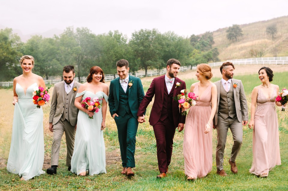 Stylish wedding party walking by Mary Costa Photography
