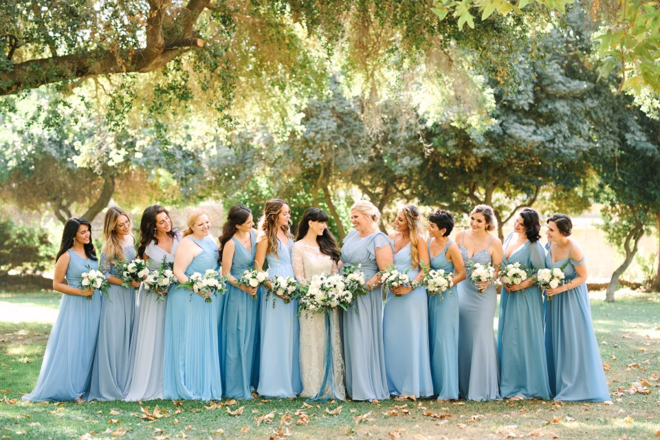 Bridesmaids in mismatched blue dresses by Mary Costa Photography