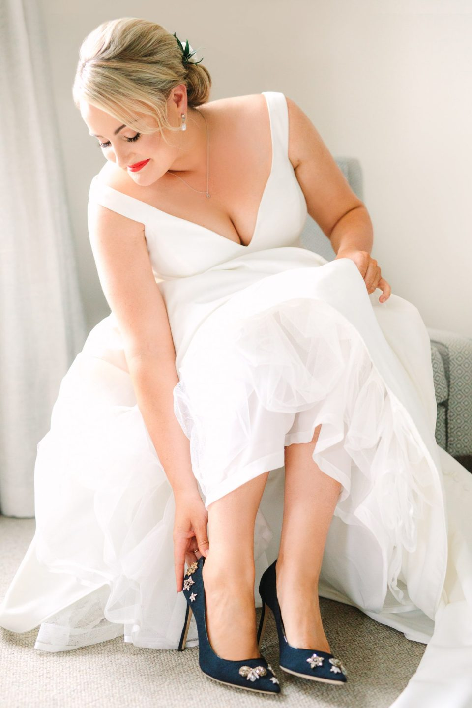 Bride putting on shoes Indian Fusion wedding at Fig House Los Angeles by Mary Costa Photography