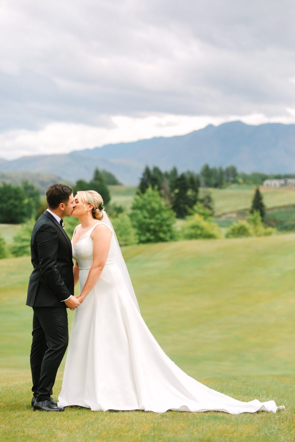 Couple kissing at Millbrook Resort New Zealand Indian Fusion wedding at Fig House Los Angeles by Mary Costa Photography