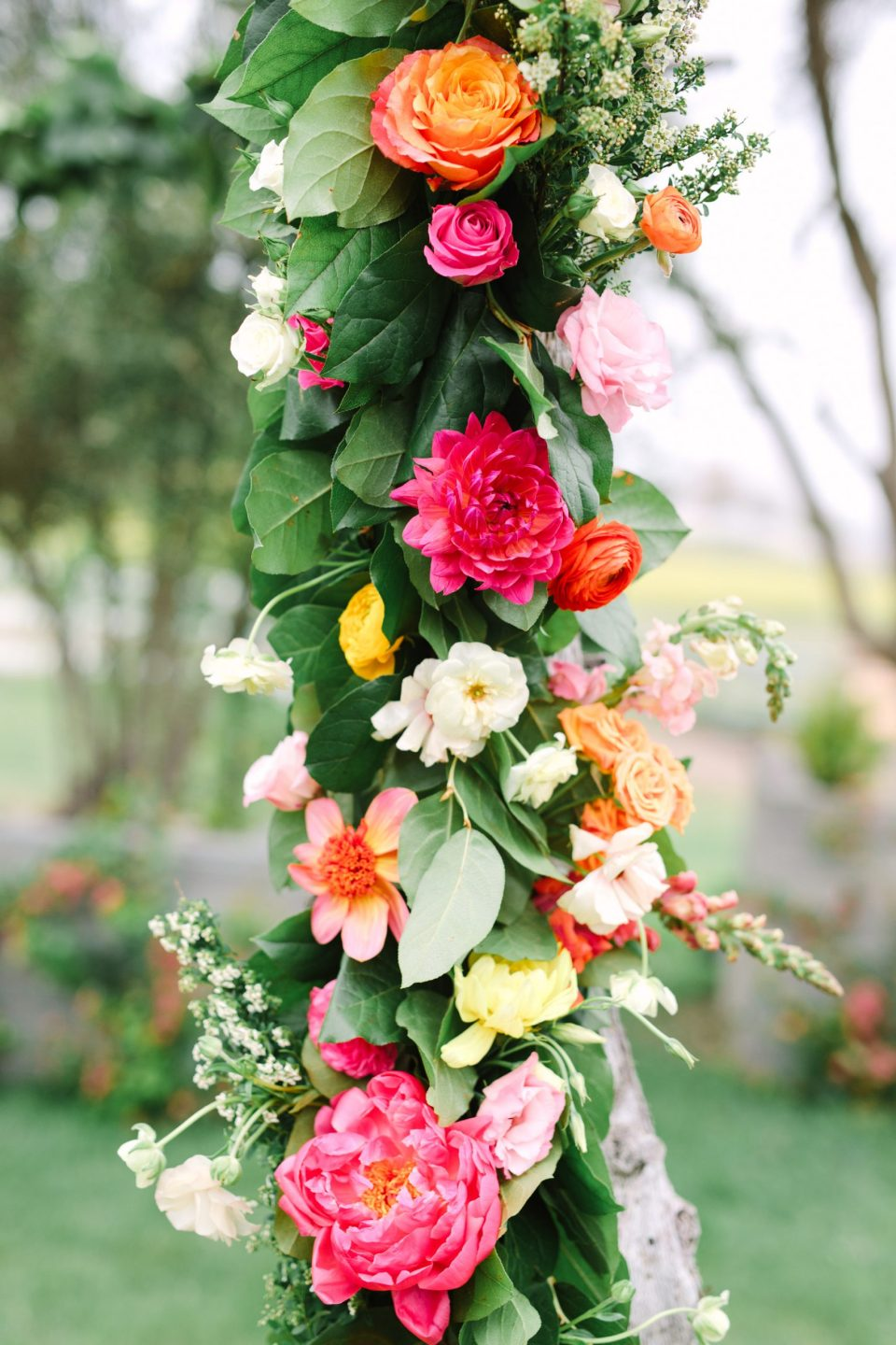 Colorful wedding arch by Mary Costa Photography