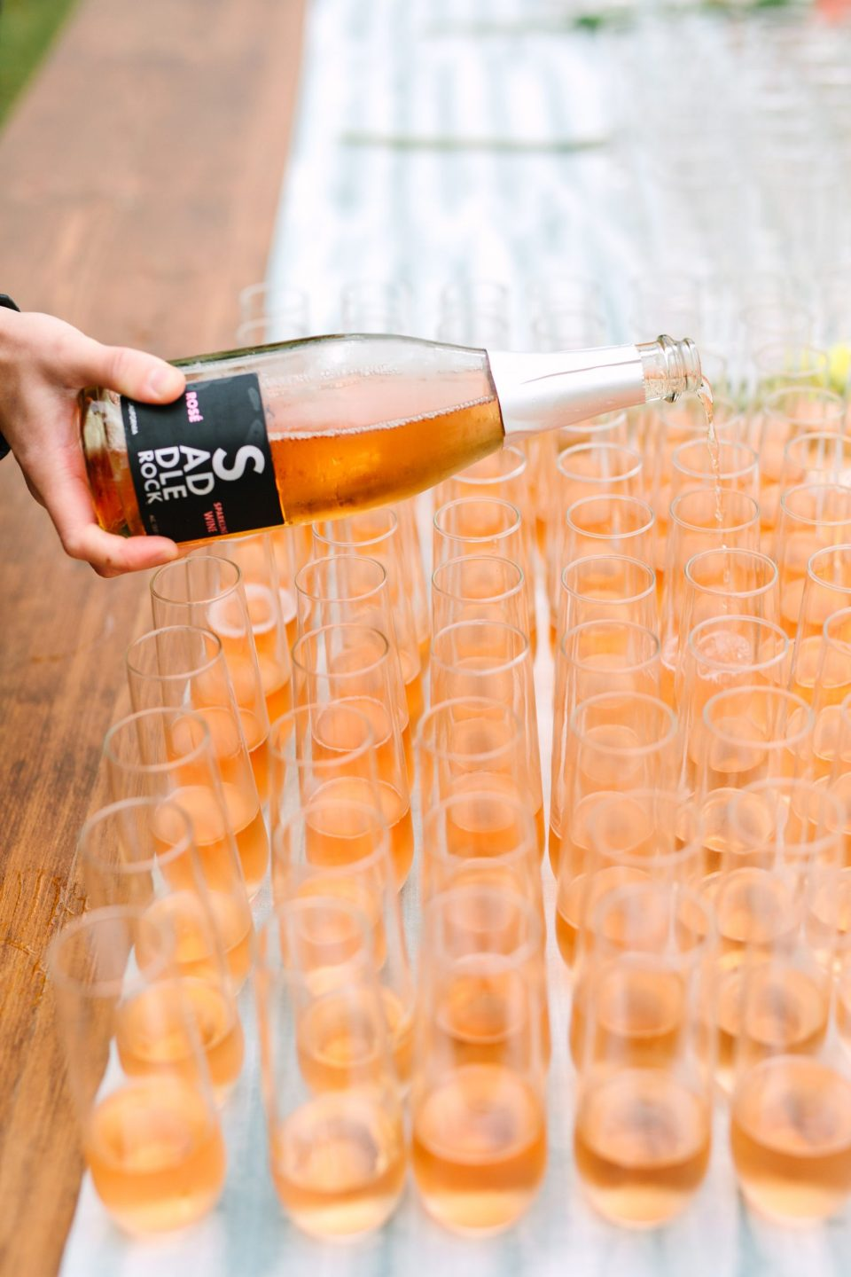 Bubbly pour at wedding by Mary Costa Photography