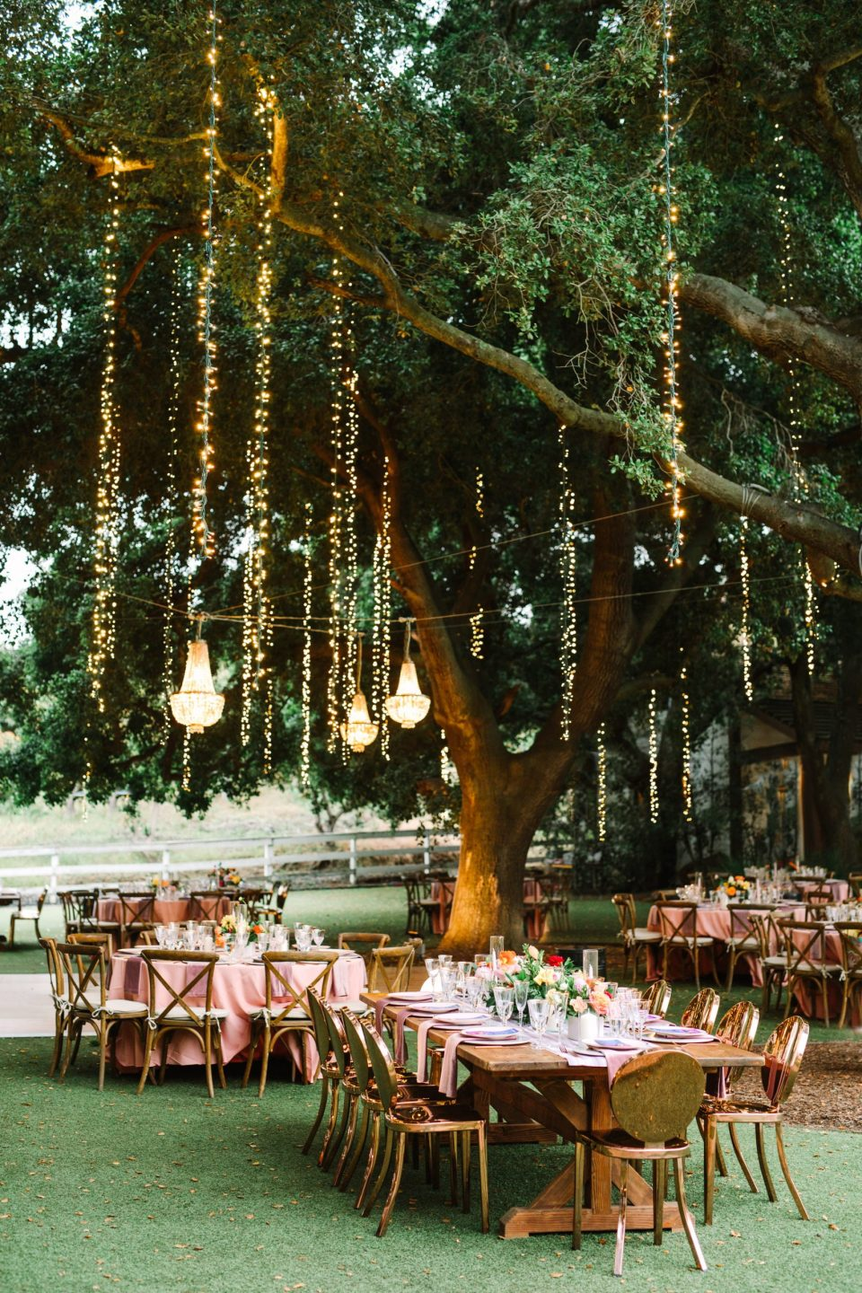 Romantic wedding reception with twinkle lights by Mary Costa Photography