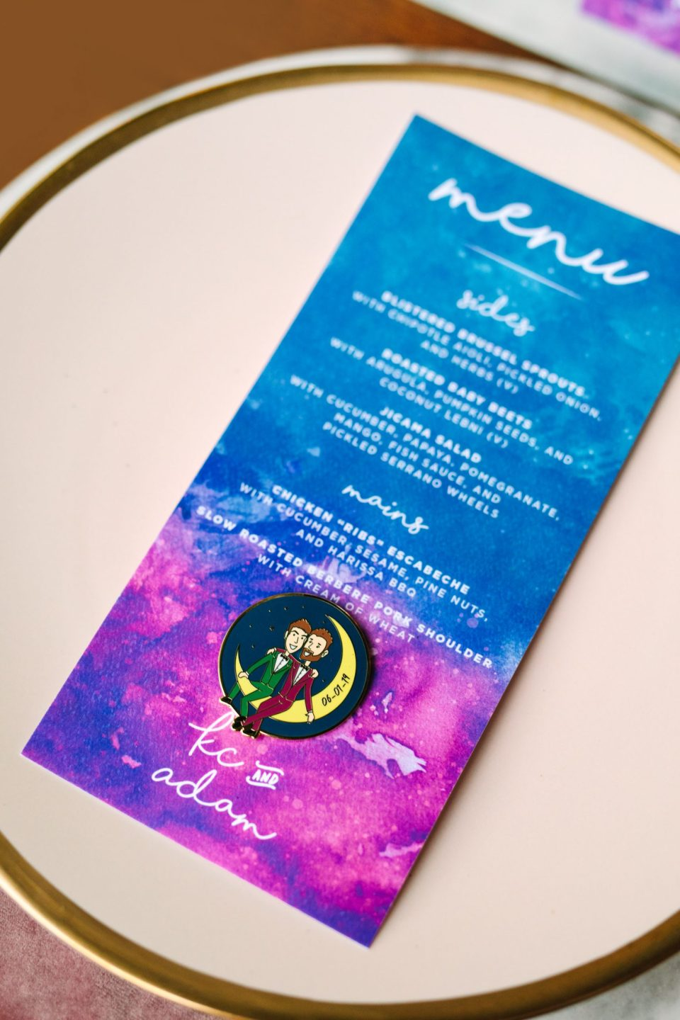 Custom menus and enamel pins by Mary Costa Photography