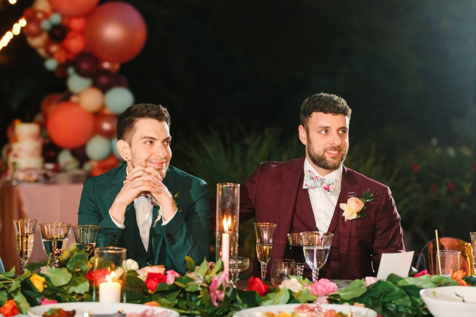 Grooms listening to wedding speech by Mary Costa Photography