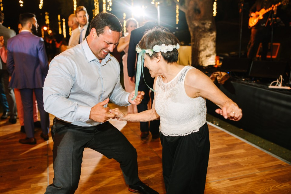 Wedding guests dancing by Mary Costa Photography