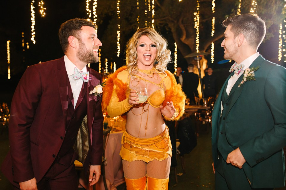 Grooms with Britney Spears impersonator Derrick Barry by Mary Costa Photography