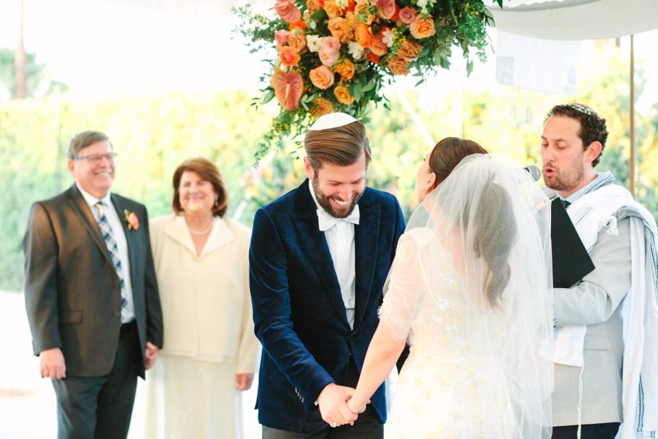 Groom laughing during wedding ceremony www.marycostaweddings.com