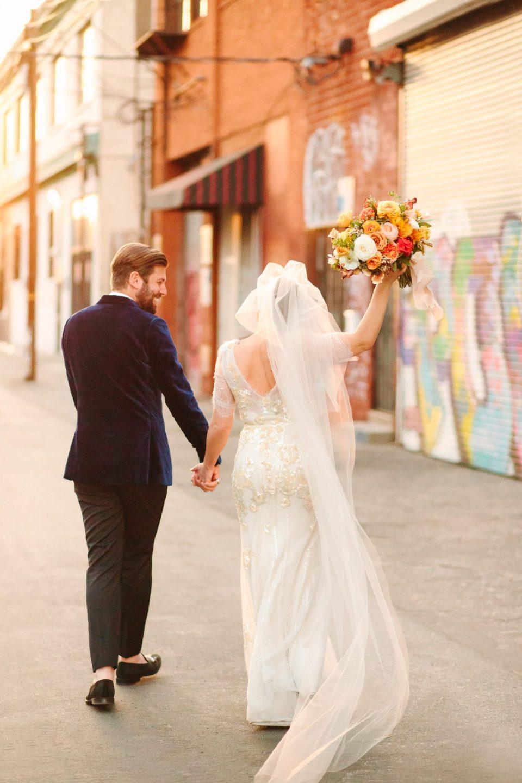Celebratory bride and groom www.marycostaweddings.com