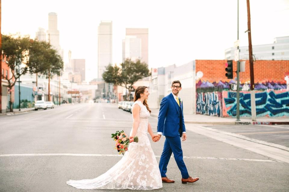 Bride and groom walking in Downtown Los Angeles near Valentine venue - www.marycostaweddings.com