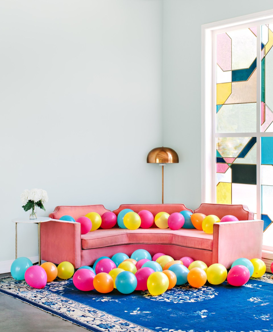 The Fig House's pink couch with colorful balloons - marycostaphotography.com