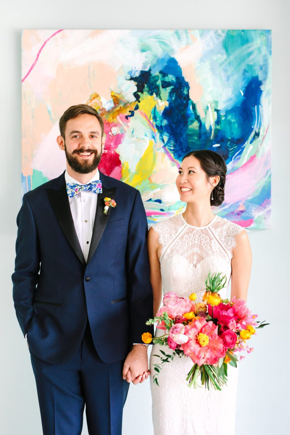 Bride and groom with colorful painting - www.marycostaweddings.com