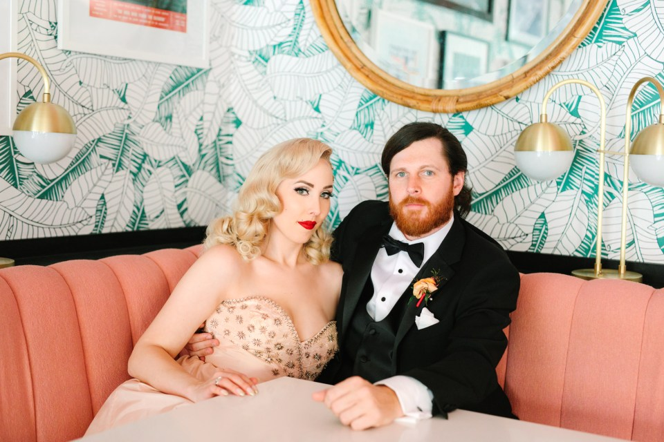Retro cool bride and groom inside the Sands Hotel and Spa Pink Cabana restaurant www.marycostaweddings.com