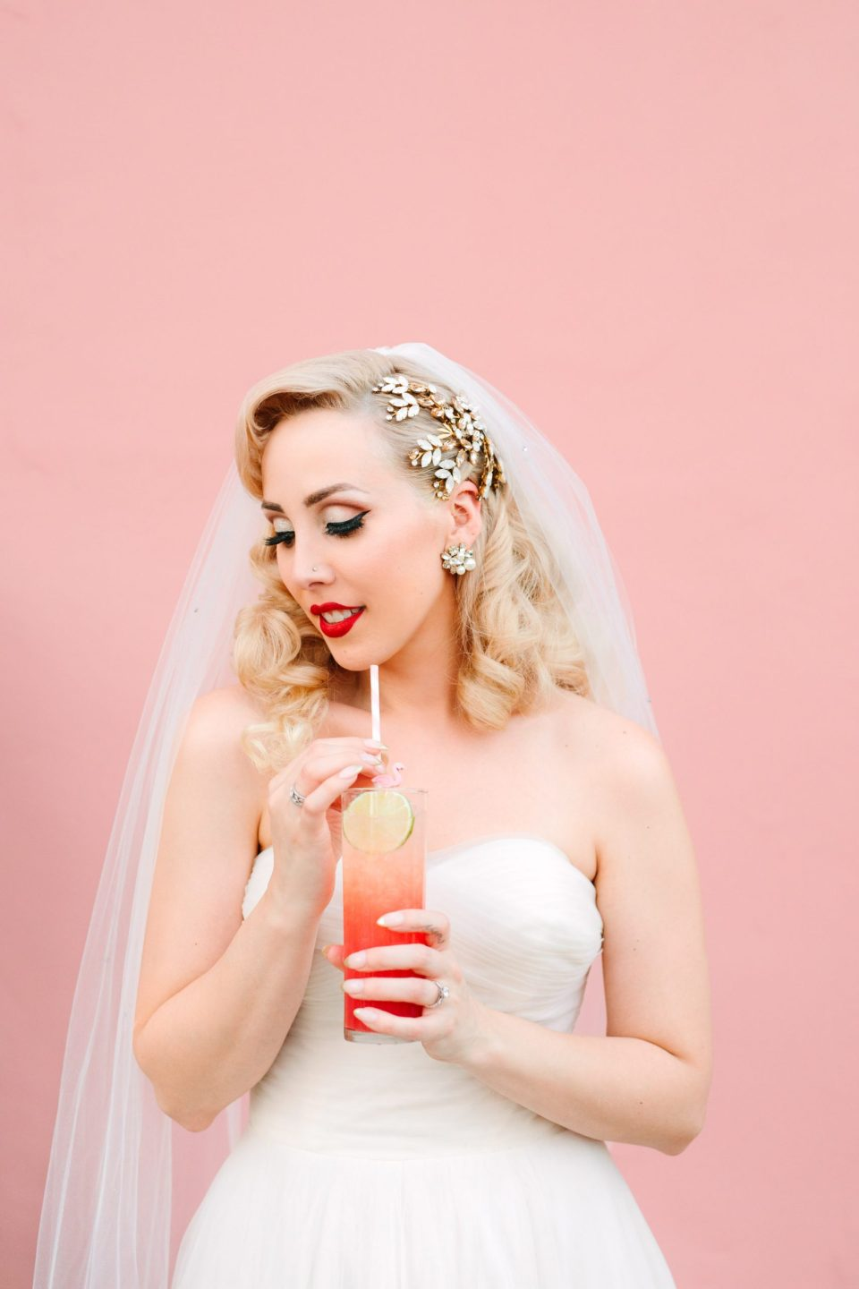 Bride with custom cocktail at pink Sands Hotel www.marycostaweddings.com