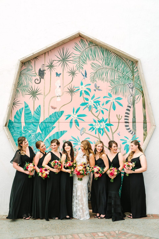 Bridesmaids in front of colorful mural door at Valentine in DTLA - www.marycostaweddings.com