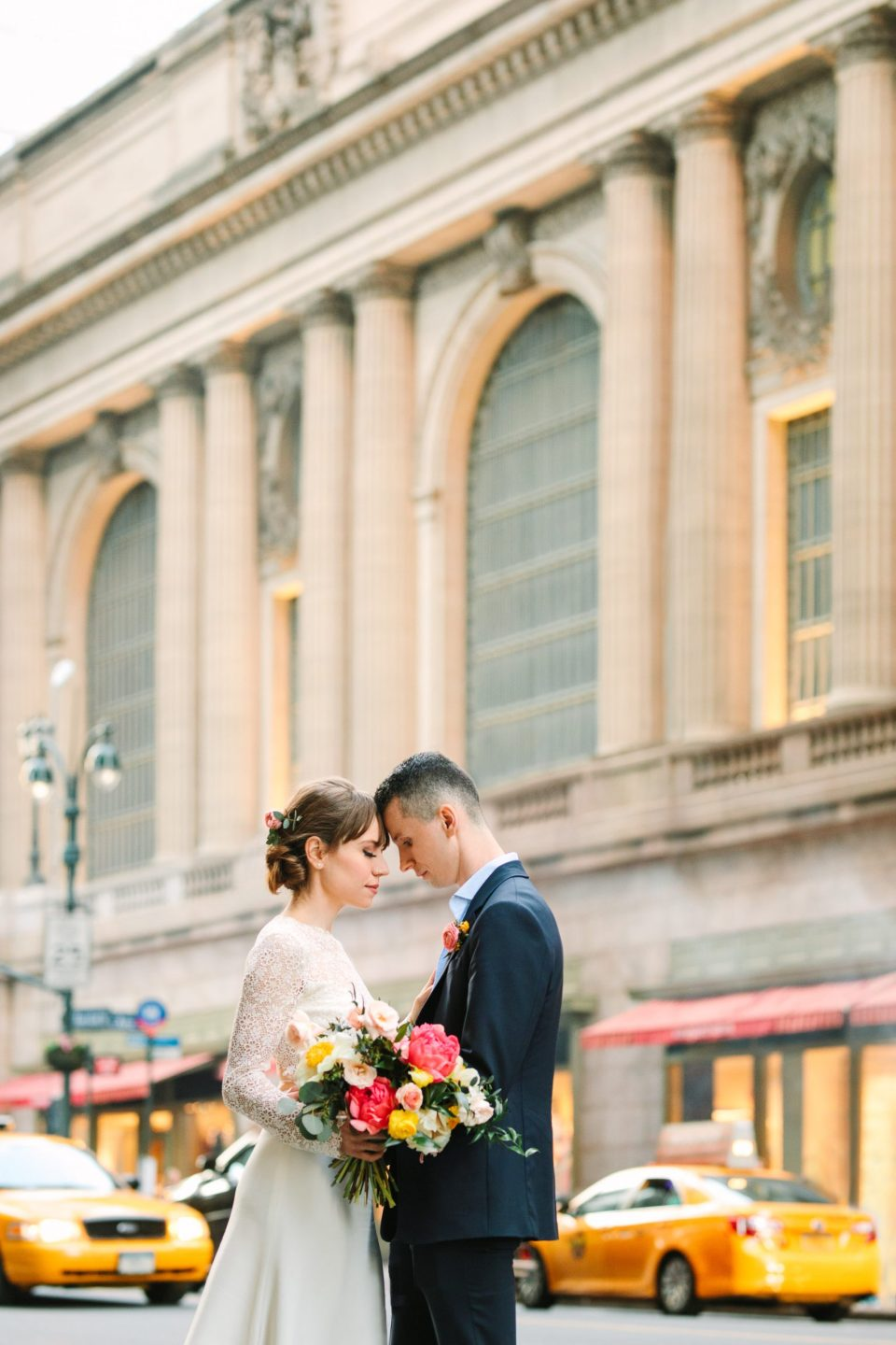 Bride and groom in front of NYC's Grand Central Station - www.marycostaweddings.com
