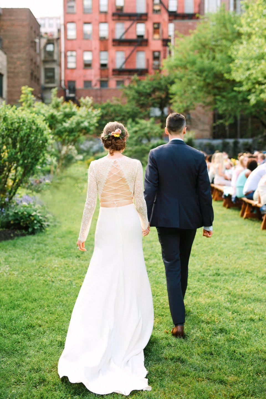 Emily and Luke walking at wedding