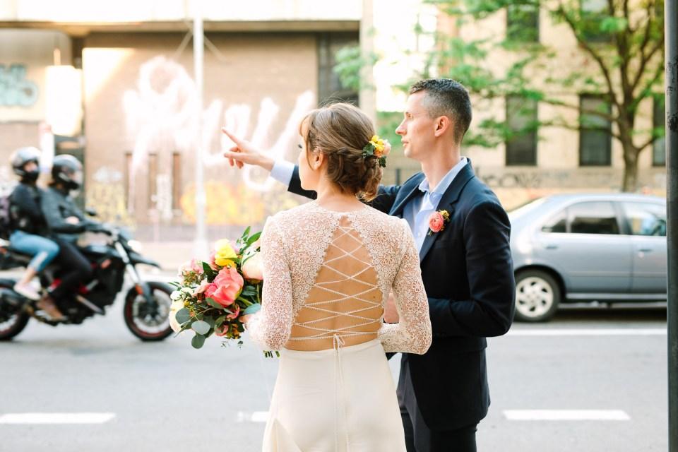 Bride and groom hailing a cab in NYC - www.marycostaweddings.com