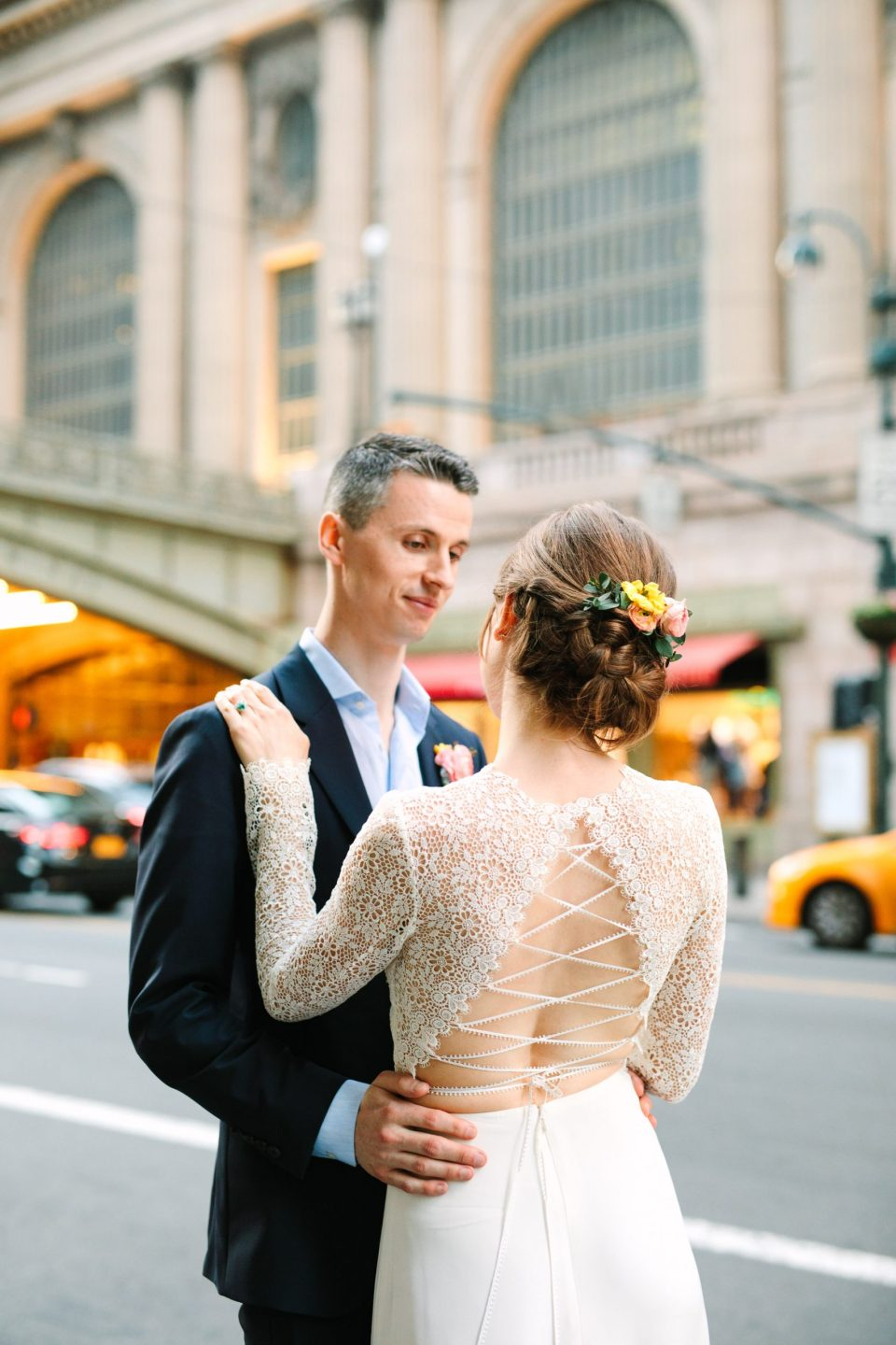 Bride and groom in front of Grand Central Station - www.marycostaweddings.com