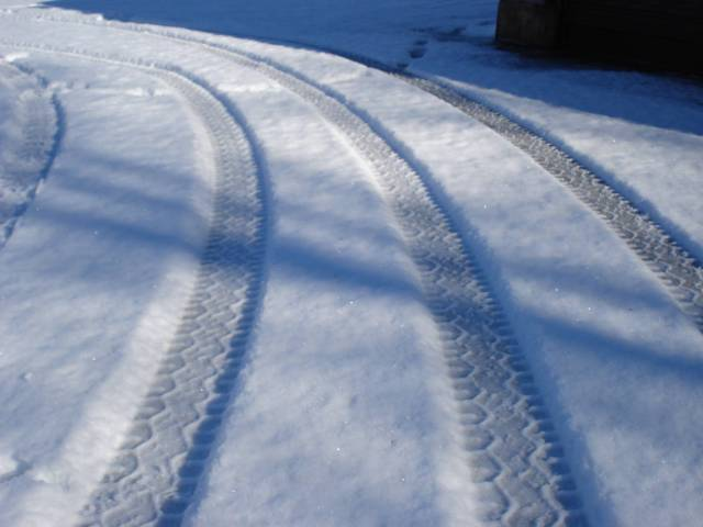 Tire tracks in snow, January 31, 2016, photo by Mary Warner.