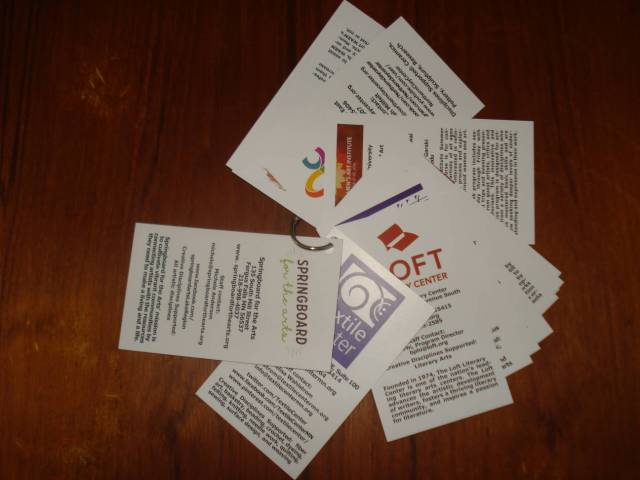 Standard arts organization cards with ring, Lake Region Arts Council Arts Resource Fair, June 25, 2016. Photo by Mary Warner.
