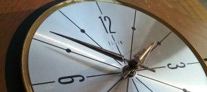 Closeup of face of Elgin wall clock, 2018.