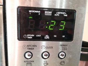Microwave clock showing 23 seconds, 2018.
