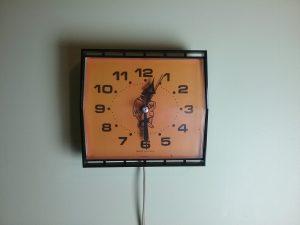 Orange and black electric wall clock, 2018.