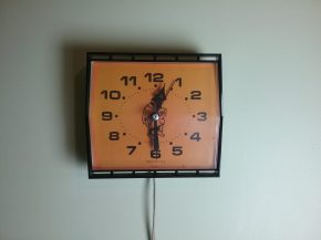 Orange and black electric wall clock, 2018.