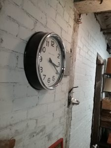 White and black wall clock, 2019.