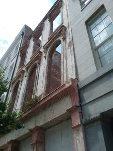 Old building facade next to The Eliza Jane Hotel, Magazine Street, New Orleans, Louisiana, August 2019. Even the facade of a building can evoke the history of a place without actually serving as a building anymore.
