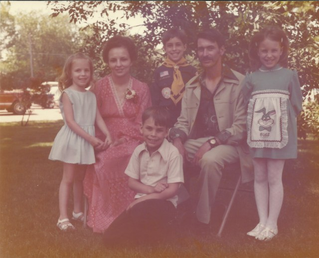 Terry and John Rasmussen and children, June 1976. Can you spot me in the Bugs Bunny dress?