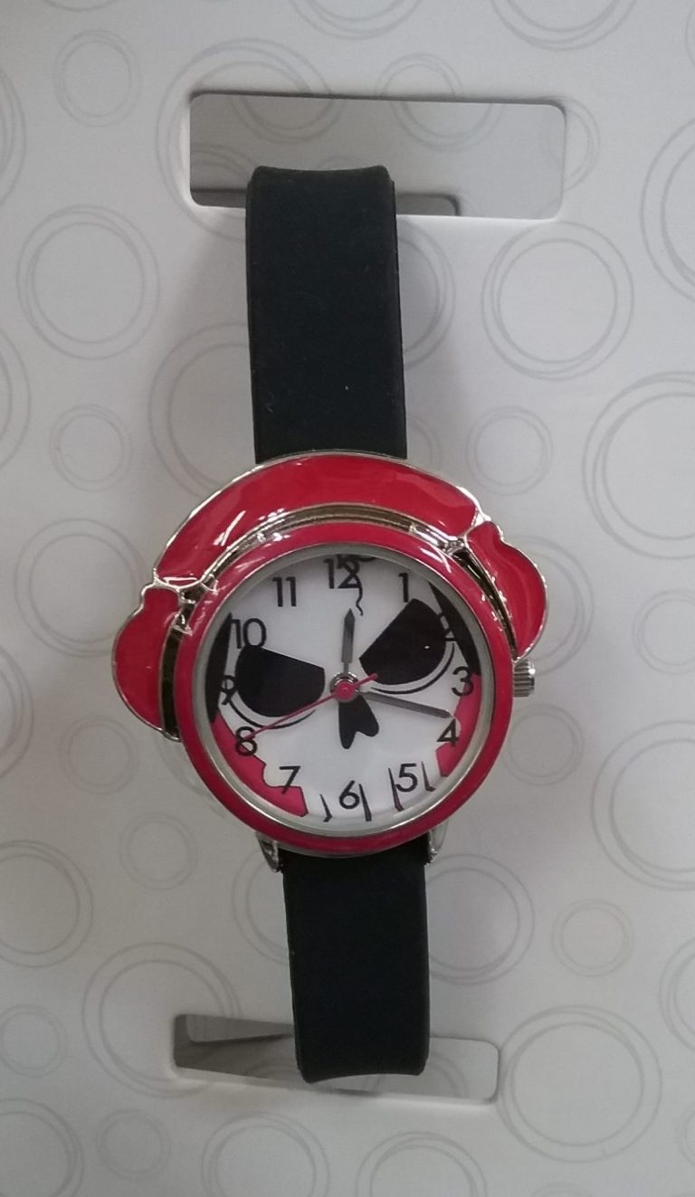 Red wristwatch with white and black skull face and black band, 2019.