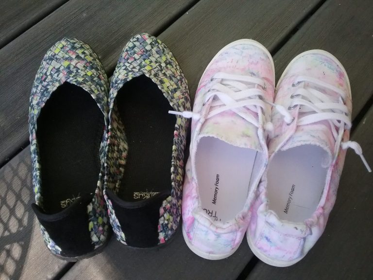 Flats with woven elasticized material and tennis shoes with elastic in the heels, June 2021.