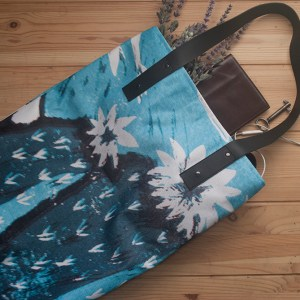 This is a photo of a turquoise cactus flower tote bag