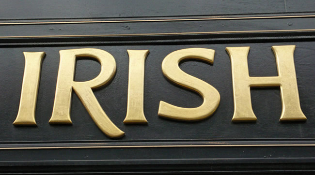 Sign Saying Irish in Gold Lettering.