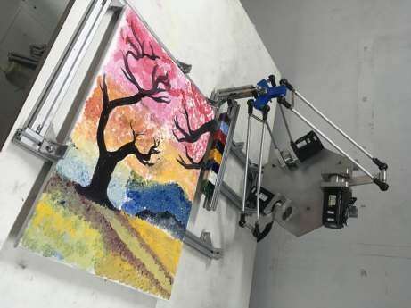 The third-prize winning robot, CMIT ReART, calculates the exact brush strokes of a human artist and replicates them robotically. (Credit: CMIT ReART)
